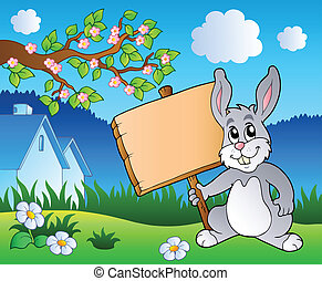 Meadow with bunny holding board