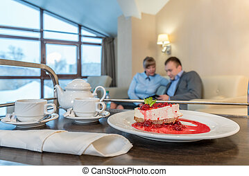 Meal delivery in room. Cake and utensils for tea
