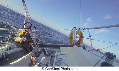 Meal on deck - Single handed ocean sailor enjoying a meal on...