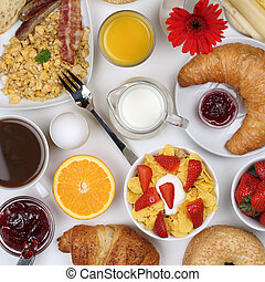 Meal with milk, fruits, coffee and orange juice from above
