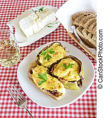 Meal with stuffed eggplants