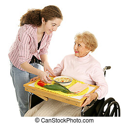 Meals on Wheels - Teen volunteer brings a meal to an elderly...