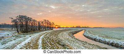 Meandering River in Frozen grassland landscape