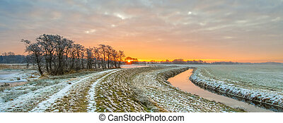 Meandering River in Frozen grassland landscape
