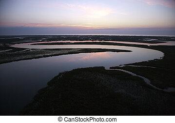 Tidal creek meandering through wetlands of Bald Head Island, North Carolina.
