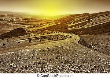 Meandering Road in Sand Hills of Judean Mountains at Sunset