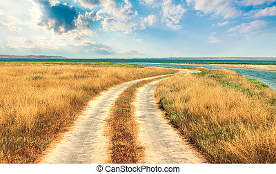 ?Meandering road to sea