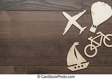 different means of transport made of wood on the table. traveling concept with copy space