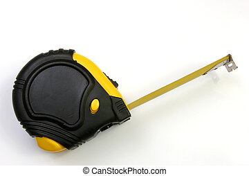 Measuring tape on its side and over view over a white background