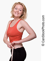 Measure waist line - Attractive blond woman wearing red and...