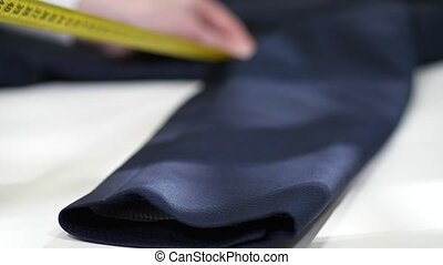 Measurement of jacket sleeve before dry-cleaning - Close-up...