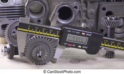 Measurement of the details by a digital caliper, Dolly shot
