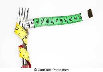 Measurement tape and fork - Fork and measurement tape on...