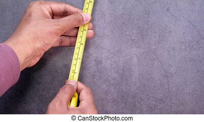 measurements on a wood with a tape measure tools. - ...