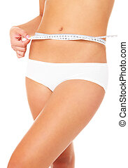 measurements - A picture of a young fit woman checking her...