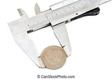 Measuring a one deutschmark coin with a caliper