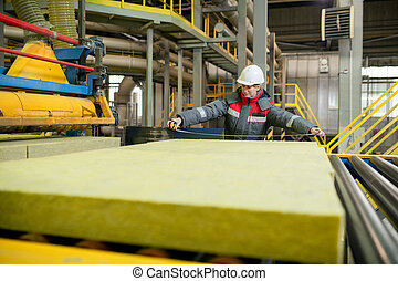Measuring construction material at factory - Production line...