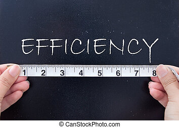 Tape measurement of the word efficiency on a chalkboard