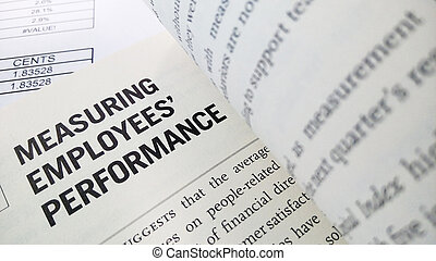 Measuring employee performance word on the book with balance sheet as background