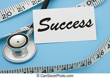 A white measuring tape with a note saying success on a blue background, measuring success