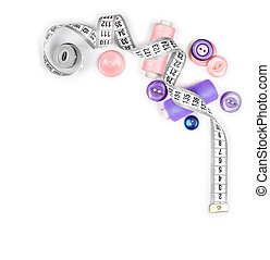 measuring tape and thread with buttons isolated on white...
