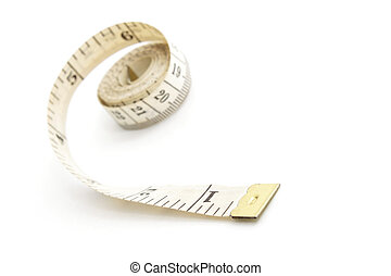 Measuring tape isolated on white background, shallow depth of field