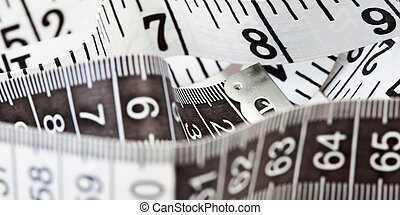 Measuring tape, symbol of tailoring and diets - Close-up of ...