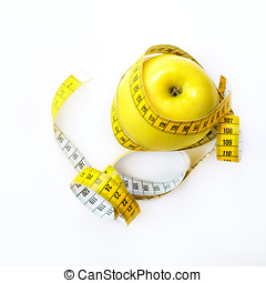 Measuring tape wrapped around fresh tasty yellow apple isolated on white background. Diet, weight loss, fitness, sport concept. Spring and summer fruit. Square