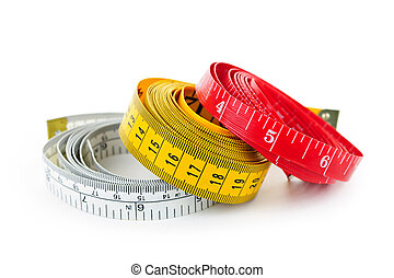 Measuring tapes - Three colorful measuring tapes coiled on ...