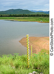 measuring water levels sign pillar on the dam