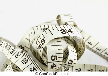 Measuting Tape - Tangled measuring tape on white with...