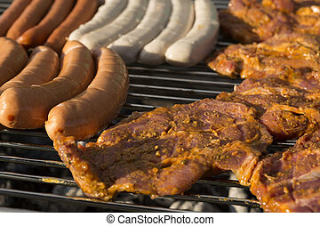 Meat and sausages on a barbecue grill