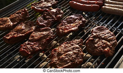 Meat and sausages on barbecue grill