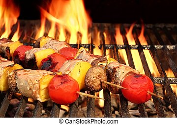 Meat And Vegetable Kebabs On The Hot BBQ Grill Closeup....