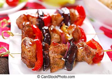 meat and vegetable skewers with teriyaki sauce