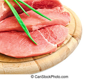 meat and vegetavles - piecies of meat with spring onion on...