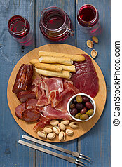 meat appetizer with red wine