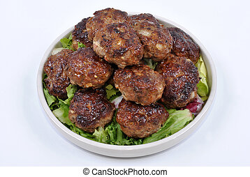 meat balls and with organic salad on a plate