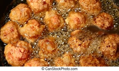 Meat balls cooking - Macro of meat balls cooking in oil