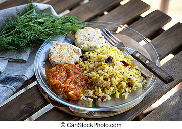 meat balls with rice and vegetables on plate