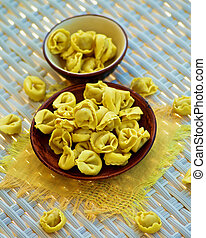Meat Cappelletti - Raw Meat Cappelletti in Brown Bowls with...