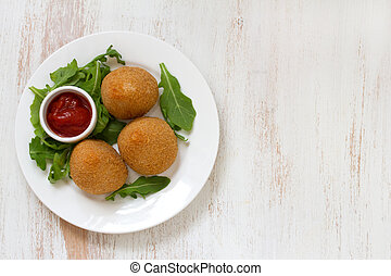 meat croquette on white plate on white background