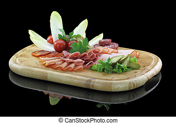 Meat delicatessen plate with vegetables