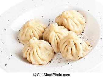 Meat dumplings served on white plate