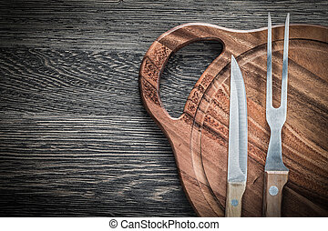 Meat fork knife chopping board on vintage wooden background