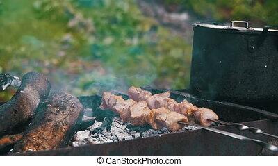 Meat Grilled on Skewers. Cooking Shish Kebab. Slow Motion -...