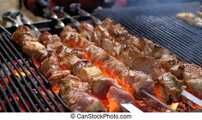 Meat Grilled on Skewers on the Grill on the Street Market....