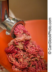 Meat grinder with mince meat - Close up of front part of ...
