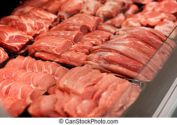 meat in supermarket - fresh meat on shelf in supermarket