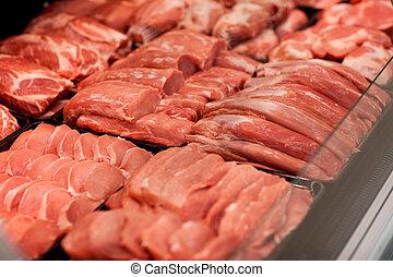 meat in supermarket - fresh meat on shelf in supermarket
